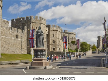 A view of Windsor Castle and Queen Victoria Statue in Windsor, England