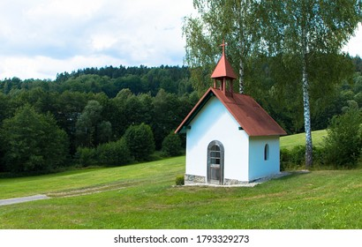 View from wine hiking trail to a small chapel, bavarian forest, Germany
