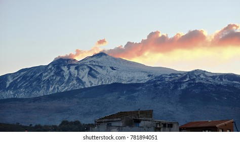 view winter Etna summit with smoke at twilight, Sicily