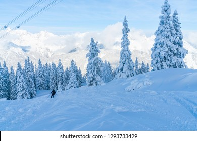 View of winter landscape with snow covered trees and Alps in Seefeld in the Austrian state of Tyrol. Winter in Austria