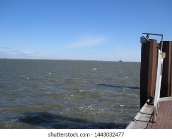 View from the Wittdun ferry terminal towards Fohr, blue sky with few clouds (Amrum, Schleswig-Holstein, Germany)