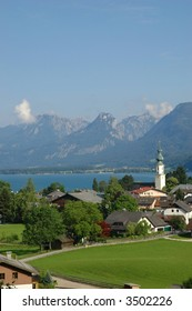 View of Wolfgangsee in Austria with town and mountains