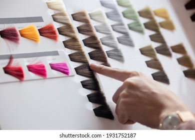 View of Woman Choosing Color from the Hair Color Chart  For Hair Dye Concept - Shutterstock ID 1931752187