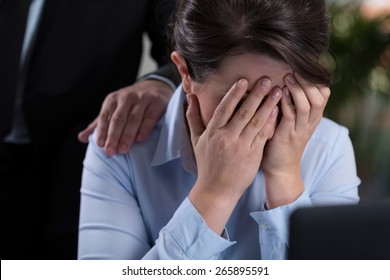 View of woman crying in the office