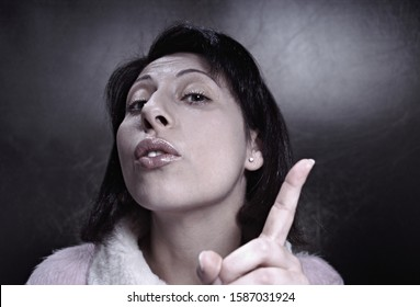 View of woman holding up her index finger