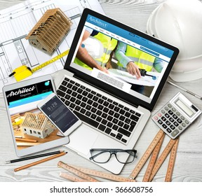 View of a Wood architect's desk in high definition with laptop, tablet and mobile