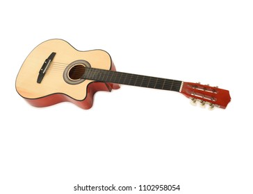 View of Wooden acoustic guitar on a white floor taken from above with space for text.