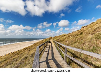View from Wooden Boardwalk at Wenningstedt towards Beach with the North Sea at Sylt / Germany