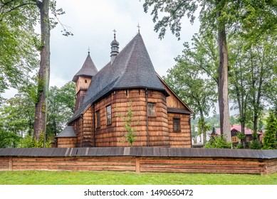 View at the Wooden Church of St. John the Baptist from 16th century in Rzepiennik Biskupi village, Poland