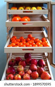 View of a wooden garde-manger fruit cellar with drawers and bug netting