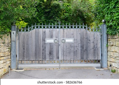 View of a Wooden Gate at the Driveway of a Country Home