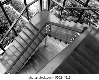 view of wooden glossy stairs from upward showing a beautiful scenery