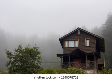 View of wooden house at high plateau, trees in fog creating beautiful nature scene. The image is captured in Trabzon/Rize area of Black Sea region located at northeast of Turkey.