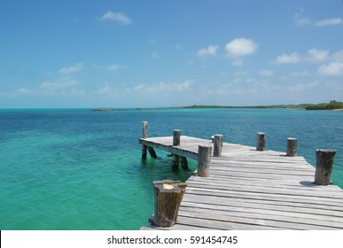 View from the wooden pier on the azure of Caribbean sea (Cuba)
