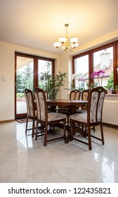View of a wooden table in dining room