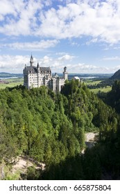View of world-famous Neuschwanstein Castle, the romantic 19th century Romanesque Revival palace built for King Ludwig II, with scenic mountain landscape in Fussen, southwest Bavaria, Germany.