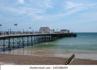 View of Worthing Pier with Rainbow Flags Fluttering on Pride Parade day.