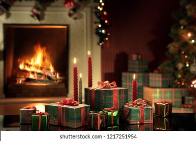 view of wrapped gifts with christmas tree and fireplace  on the back