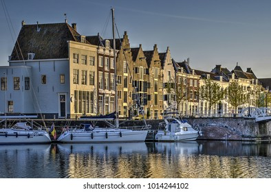 View of yachts and houses at the Inner Harbour or Binnenhaven in Middelburg, the Netherlands, illuminated by the late afternoon sun