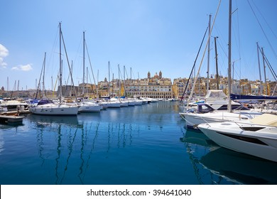 The view of yachts moored in the harbor in Dockyard creek between Senglea and Birgu  with Senglea peninsular on background. Malta