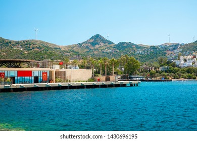View of the Yalikavak Bodrum Marina, sailing boats and yachts in Bodrum town, city of Turkey. Shore and coast of Aegean Sea with yachts and boats