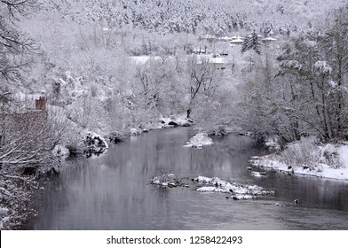 View of the Yantra river from the bridge in the town of Veliko Tarnovo, Bulgaria, in the winter