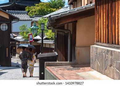 """View of Yasaka-dori area with Hokanji temple (Yasaka Pagoda), near Sannen-zaka and Ninen-zaka Slopes. Here is the most photogenic landmark in Kyoto, Japan. Text in Japanese on the flag is """"shaved ice"""""""