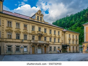 View of a yellow hotel in the austrian spa and ski resort bad gastein.