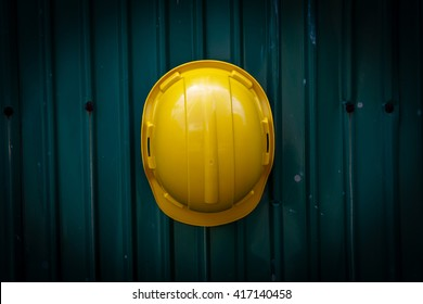 view yellow Safety Engineer Helmet ,with metal sheet background