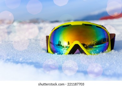 View of yellow ski mask on white icy snow