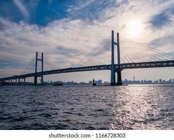 View of Yokohama bay area in Yokohama City, Kanagawa Prefecture, Japan. Yokohama Bay Bridge is a diagonal bridge connecting Honmoku Pier and Daikoku Pier.