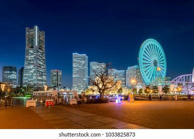 View of Yokohama cityscape in Minato Mirai area of Yokohama City in Kanagawa, Japan at dusk.
