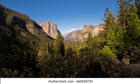 View of Yosemite Valley form Tunnel View showing El Capitan, Half Dome and Bridalveil Falls in the distance.