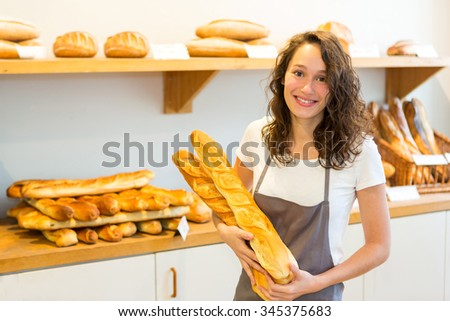 View of an Young attarctive baker working at the bakery