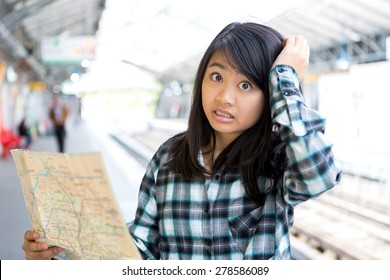 View of a Young attractive asian tourist lost in Paris