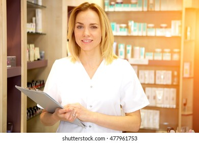 View of a Young attractive beautician working in a beauty salon