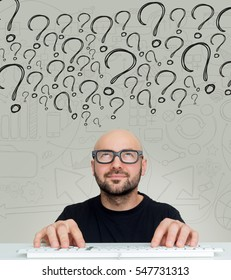View of a Young attractive bold man geek with glasses asking question to himself