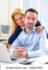 View of a Young attractive couple using laptop