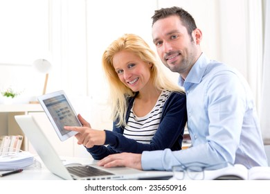 View of a Young attractive couple using tablet at home
