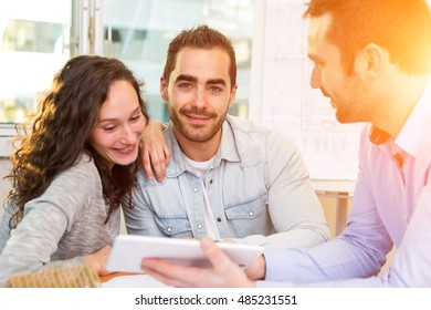 View of a Young attractive people meeting real estate agent at the office