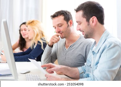 View of Young attractive people working together at the office
