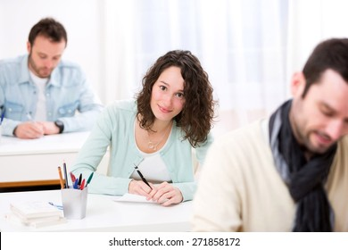 View of a Young attractive student taking exams