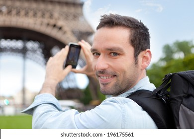 View of a Young attractive tourist taking picture in Paris