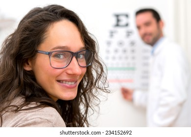 View of a Young attractive woman doing optician test