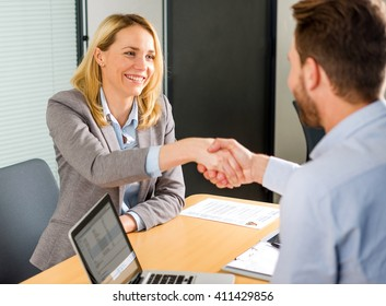 View of a Young attractive woman handshaking at the end of a job interview