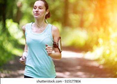View of a Young attractive woman running in the forest