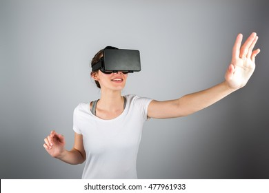 View of a Young attractive woman using a virtual reality headset for first time