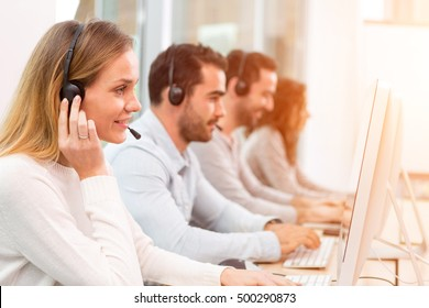View of a Young attractive woman working in a call center