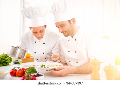 View of a Young attractives professionals chefs cooking together