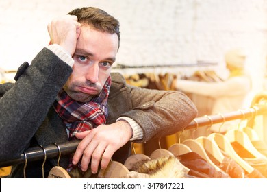 View of a Young casual man waiting while his wife's shopping